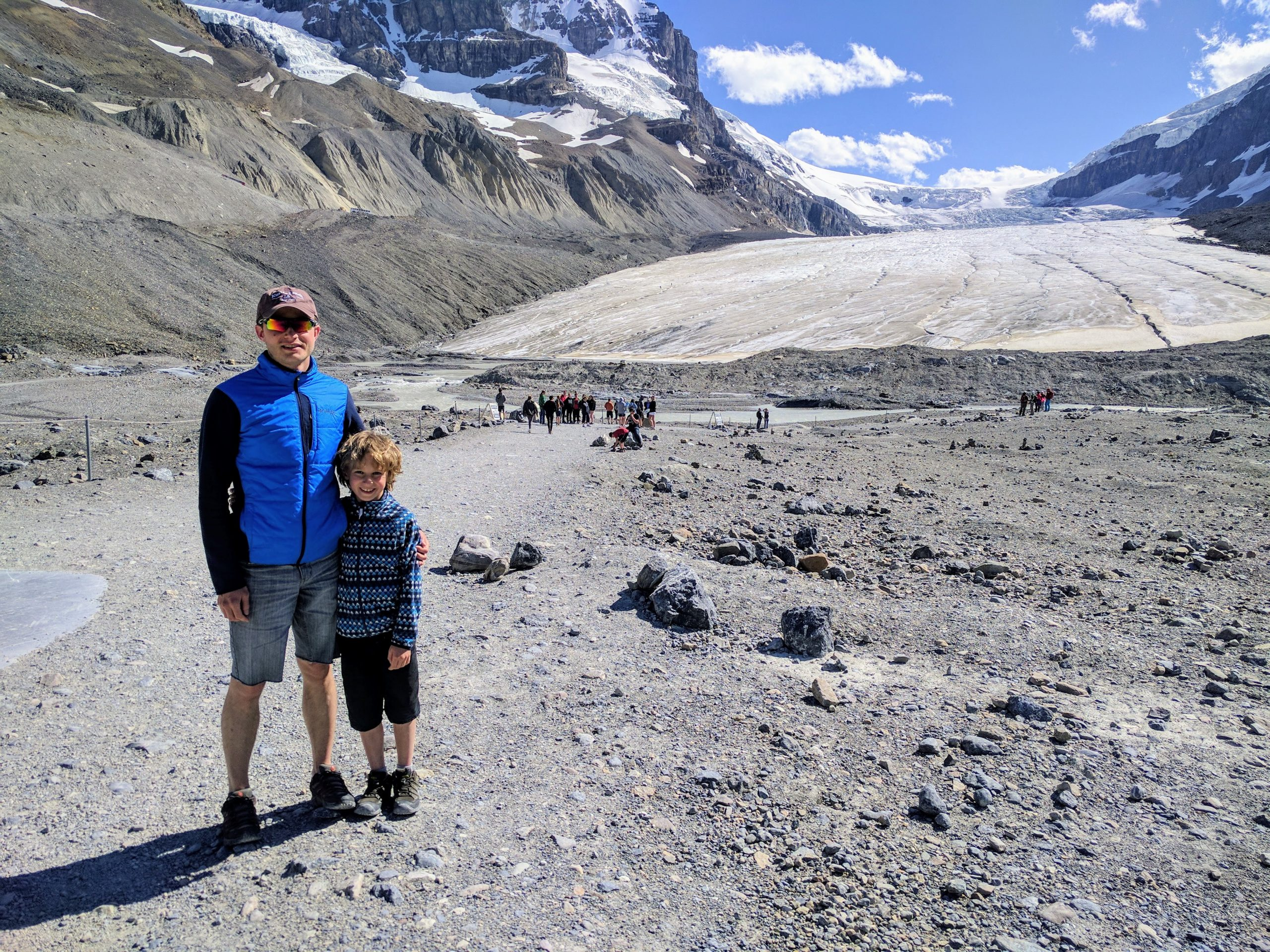 Athabasca Glacier with children: Leonid and Artem posing in front of the ice giant. Jasper National Park