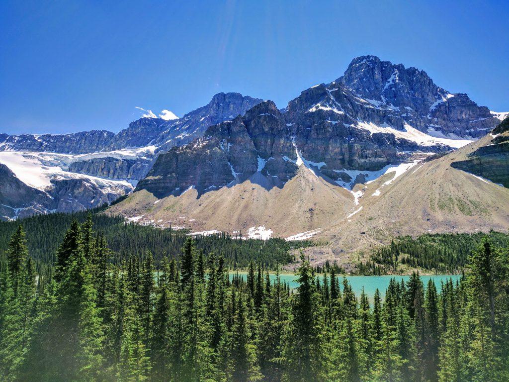 Banff Jasper 5 Days Itinerary: Crowfoot Glacier (upper left corner) hanging above Bow Lake.