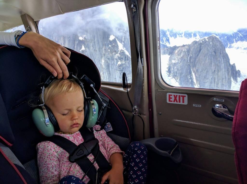 Erika sleeping peacefully during Denali Flight Tour, Alaska