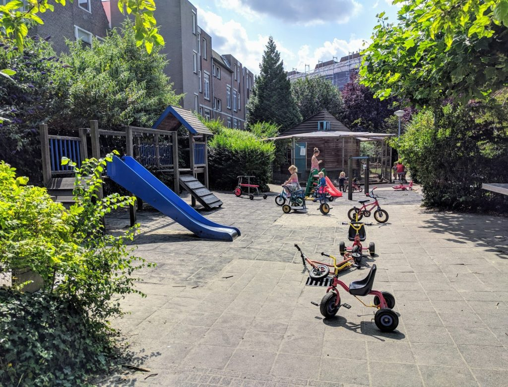 Playground with bunnies, chickens, and sandbox in the middle of Jordaan